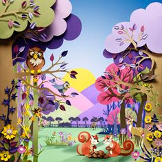 A colourful woodland scene for Cadburys by Helen Musselwhite created through papercutting for multi-layered scenes.