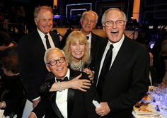 M*A*S*H All looking a little white haired! :) Alan Alda and that laugh.