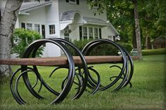 "Arcadian Backyard Bench.   Custom made by Michael Route, Red Iron Studio in Wisconsin Forged iron bench out of 1 1/2"" round"