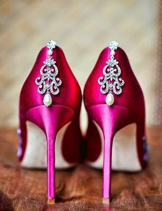DIY Wedding Shoes. Attach a pair of sparkly earrings to the back of a pair of plain satin shoes for a glam look.