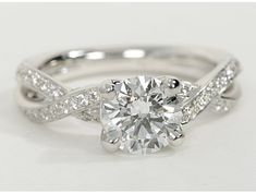 This twist pave diamond engagement ring is stunning. I even like the round center stone.
