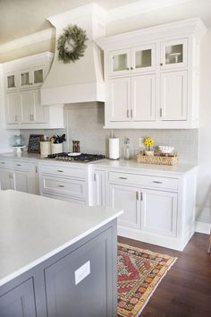 The backsplash is a light gray subway tile, color is called Pumice, made by H-line. Grout color is Driftwood.Beautiful Homes of Instagram