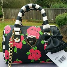 GREAT PRICE BETSEY JOHNSON MINI BARREL FLORAL Very cute mini bag with detachable crossbody straps. Gold hardware, signature Betsey Johnson lining inside. Woukd make a great gift. Brand new with tag. Betsey Johnson Bags Mini Bags
