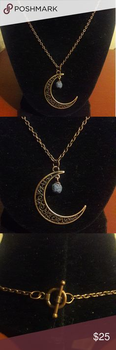 """Handmade Moon Necklace with Blue Lava Rock Handmade by me!  This moon necklace has a blue lava rock, which is great for putting your favorite essential oils on.  Makes a great diffuser!  Or wearing just because it looks amazing!  The necklace has a 20"""" chain and a toggle clasp in the back.  Be sure to check out my closet.  I offer a discount for bundling! Jewelry Necklaces"""