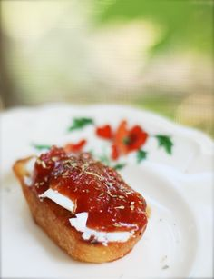 mini garlic toasts with goat cheese and tomato jam ~ a lovely Friday night appetizer with a glass of wine.