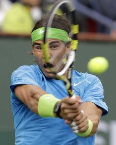 Rafael Nadal, of Spain, returns a shot to Roger Federer, of Switzerland, during a men's semifinal match at the BNP Paribas Open tennis tournament Saturday, March 17, 2012, in Indian Wells, Calif. (AP Photo/Darron Cummings)