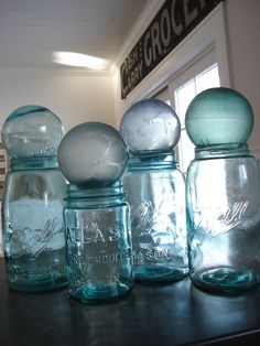 ball jars..interesting use of glass floats