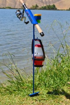MiniFighter Fishing Rod Holder - MADE IN USA the MiniFighterTM stands approximately 3 feet tall to keep your reels clean above sand and water. Handy accessory hook is great for night time fishing to hang a flashlight, lantern or a towel. up to 100 lbs. stress tested for weldment quality !