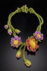 beadjeweledinc.com: The following are some of my creations that have won prizes in various competitions.  Monet's Impression - Water Lily  Bead Dreams 2009 Finalist! Water Lillies float on a tangle of vines with buds dripping from the vines.    Free shipping. Price: 160.00.