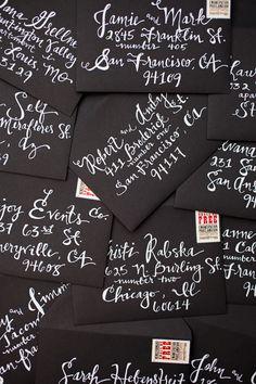black envelope, white calligraphy by Ryanne Steele (steelemyheart on IG)