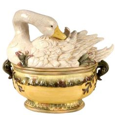 Goose Tureen & Ladle by Kaldun & Bogle. A coat of downy white feathers lends a stunning look to this gorgeous goose tureen.  Used as a fine centerpiece for the table or as a soup tureen this handpainted ceramic tureen with a crackle finish will certainly be a collector's favorite. Elegant way to serve a winter soup.