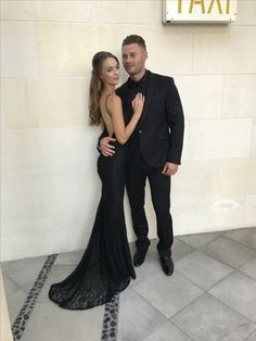 Black lace formal gown with low back and fishtail cut with long train. Gown by STUDIO MINC #prom #formal