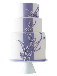 Top 50 Prettiest Wedding Cakes! A Modern Purple Wedding Cake Looking for a bold cake design? Try a thick, simple stripe, accented with a delicate floral design.