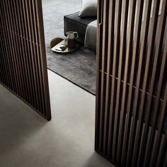 Sail sliding panel with heat-treated oak veneered aluminum structure and grey transparent glass.