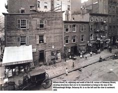 1901. Buildings to be demolished on SE corner of Delancey to make way for the Williamsburg Bridge.