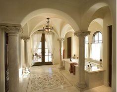 Polished travertine columns at master tub