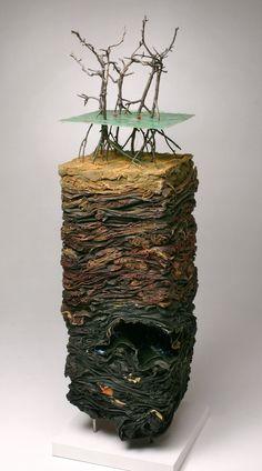 Michael McGillis. Studio Work. Micro Disasters. Petrobras Drilling Field, Coastal Brazil, 2003. Denim work clothes, matress, epoxy resin, mixed media.  Website