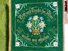 """""""Sitt und Tracht der Alten wollen wir erhalten""""; translated: """"We uphold the old customs and costumes""""."""