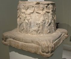 Cylindrical altar. Found on Melos. Adorned with a representation of the troup of Dionysos, with Dionysos himself shown drunken and supported by a Satyr, and also Pan. 4th BC  National Archaeological Museum, Athens, Greece.
