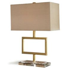 A cubist-inspired geometric lamp in a gold form that is set on a crystal base. Each piece is made by hand by artisans and is unique.    Finish: Hapsburg Gold