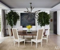 In Nancy Gonzalez's Colombia apartment, a chandelier by Hervé Van der Straeten from Ralph Pucci International crowns the dining area; Jean-Louis Deniot designed the straw-marquetry table, Louis XVI–inspired chairs, and silk-wool carpet; and the painting is by Jason Martin   archdigest.com