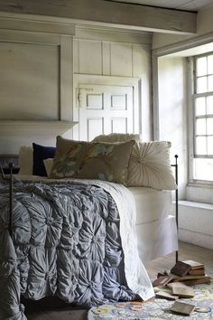 love the bed and lighting on the white walls - bright but cozy
