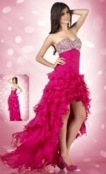 This is a gorgeous high-low prom dress at an very affordable price.  It features a richly beaded well defined sweet-heart neckline. Dramatic ruffle accent extend along the skirt, which segues into a flared floor-length style with train. While the style corset that fits in the back ensures a proper fit. This is a perfect high-low dress for a prom, homecoming, graduation, military ball and any special occasion.  Made in Silk Chiffon.  Sizes available: 4-16  Embellishments: stones, beads…