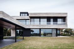 The FSY House Overlooks a Lagoon Just Outside of Buenos Aires - Design Milk