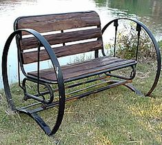 Groovystuff Iron Wagon Wheel Rustic Teakwood Glider Bench