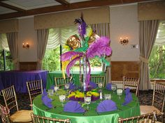 Mardi Gras themed centerpiece for a sweet 16 event by The Prop Factory, via Flickr