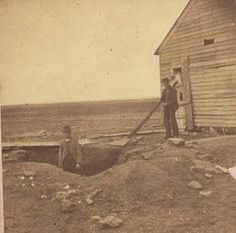 This photo from 1873 shows the excavated grave of a victim of the Benders. The grave was found under a trapdoor at the Bender house in Labette County.