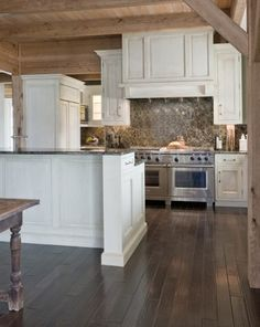 white cabinets/ rustic floor