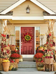 Fall Front Porch Ideas | Fall Decor-By using baskets and wooden crates, to assemble the base of your display; this adds structure. Then fill in with cornstalks, flowers, and fruits.