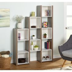 The reclaimed finish look adds a touch of sophistication to this stylish room divider. Features seven enclosed cubes and open shelving to display photos, collectibles and books. You will love the vers