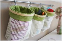 Cloth bags held open with embroidery hoops hang from a curtain rod…easy access and a great storage idea for small items.