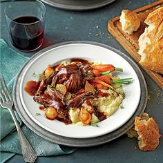 Beer-Braised Pot Roast | This is no ordinary pot roast. First, it's rubbed with coffee. Then it simmers in dark stout beer and beef stock, yielding a deeply delicious gravy. Small carrots with tops and pearl onions elevate it further. Just be sure to pile the veggies on top of the beef after all other ingredients are in your cooker, so they'll cook perfectly and keep a vibrant color.