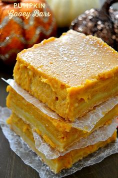 These Pumpkin Gooey Bars are FANTASTIC! So amazingly easy to prepare and taste like fall! These Pumpkin Gooey Bars are fantastic! Loaded with buttery pumpkin flavor and sweet spices, you'll love these fall-inspired bars! Fall Desserts, Just Desserts, Delicious Desserts, Dessert Recipes, Yummy Food, Thanksgiving Desserts, Pumpkin Bars, Pumpkin Dessert, Pumpkin Spice