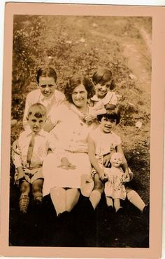 Antique photograph woman with four children and little girl holding doll Selling on ebay