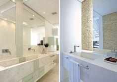 Banheiro de casal com cuba dupla e sem divisão moldada no mármore branco.