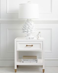 You can never go wrong with this chic nightstand. Pair it with our artichoke lamp to make a statement.