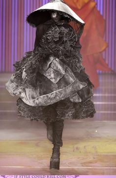 By John Galliano. I want to use that ashy look on the edges of a momento mori costume I am planning.