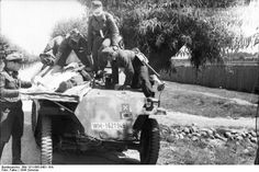 German troops transporting a wounded soldier with a SdKfz. 251 halftrack vehicle, Eastern Front, 21 Jun 1944