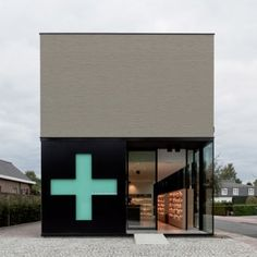 Pharmacy M by Caan Architecten. this is so neat the green cross is a sliding door