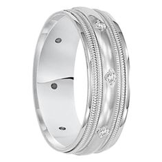 The band is made of 14kt. Solid White Gold with Double Milgrain Edges and .20 cwt Eternity Set Diamonds (8 diamonds total). It includes a lifetime warranty.