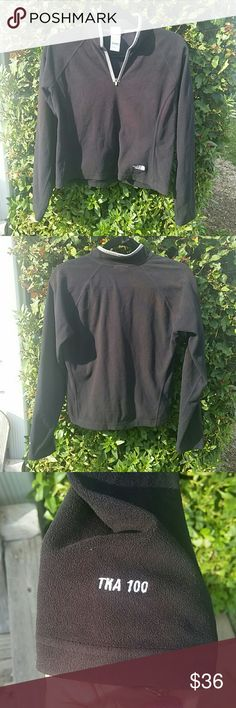 North Face TKA 100 black fleece pullover North Face black fleece pullover.  Quarter zip with tan collar.  In excellent condition North Face Jackets & Coats