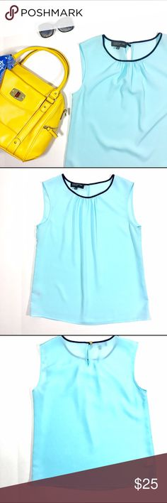 """Jones New York Tank Create a sleek, sophisticated style this spring in this Jones New York sheer aqua tank top. Scoop neck and keyhole design on the back. 19"""" armpit to armpit, 25"""" shoulder to hem. A28 Jones New York Tops Tank Tops"""