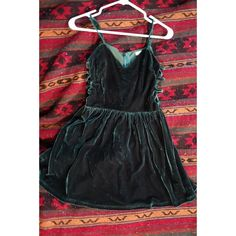 Dark green velvet skater dress Dark green velvet skater dress with side cutouts…