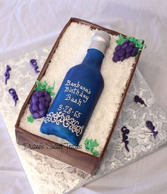 Wine bottle cake.  Of course I would make it all in buttercream and not fondant.