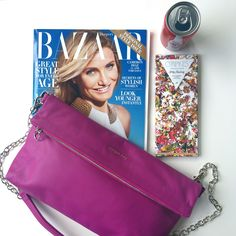 All of our favorite things: fashion mag, chocolate, Coke and our Adele handbag.