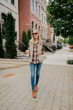 Fall style. Create a cute Fall outfit with AG jeans, brown booties, Patagonia vest, and a Fall inspired flannel.
